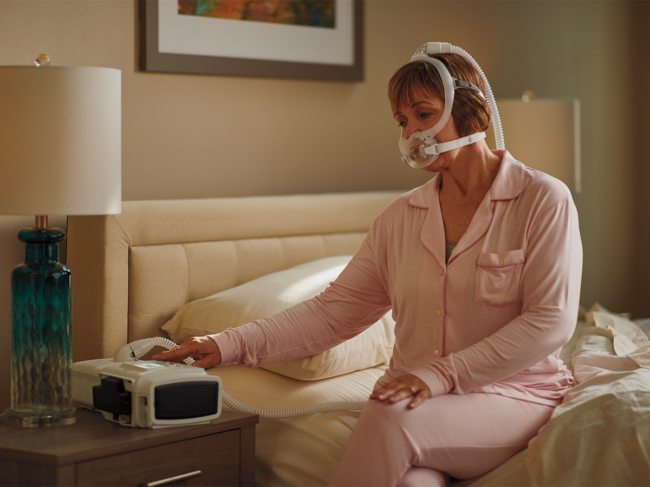 Patient using device at home