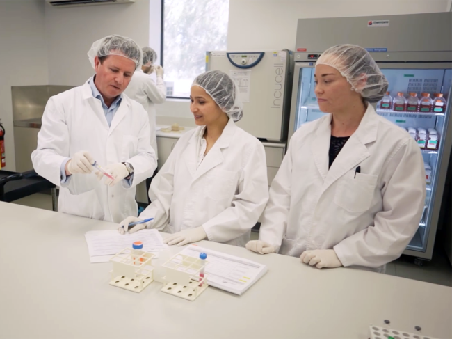 Orthocell CEO with employees in the lab