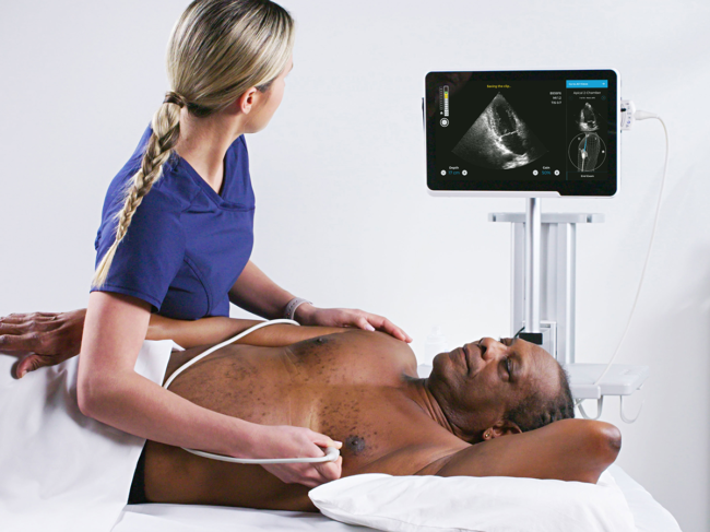 Clinician scanning patient