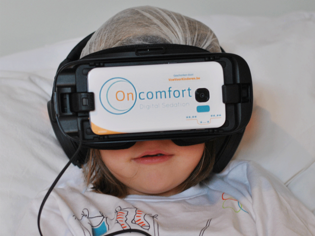 VR headset on child in hospital bed