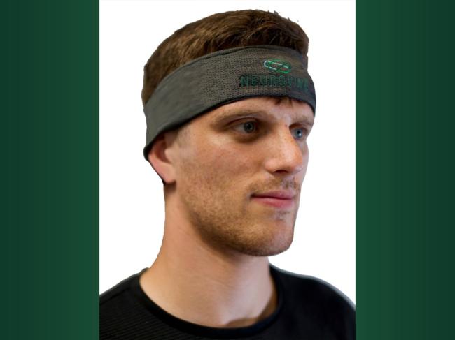 Man wears Neurovine device around forehead