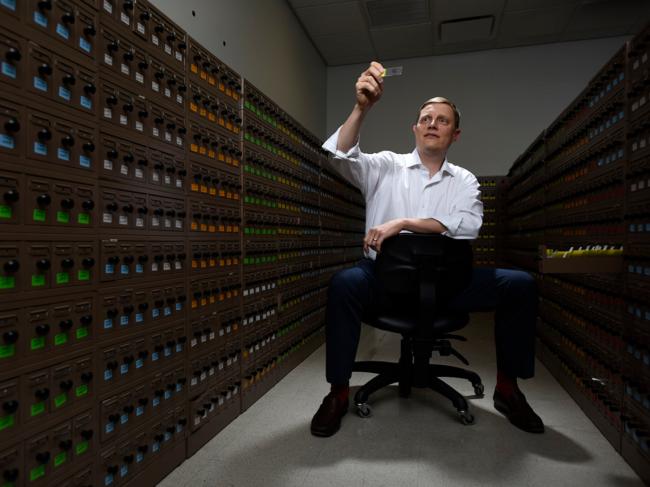 David Spetzler holding microscope slide