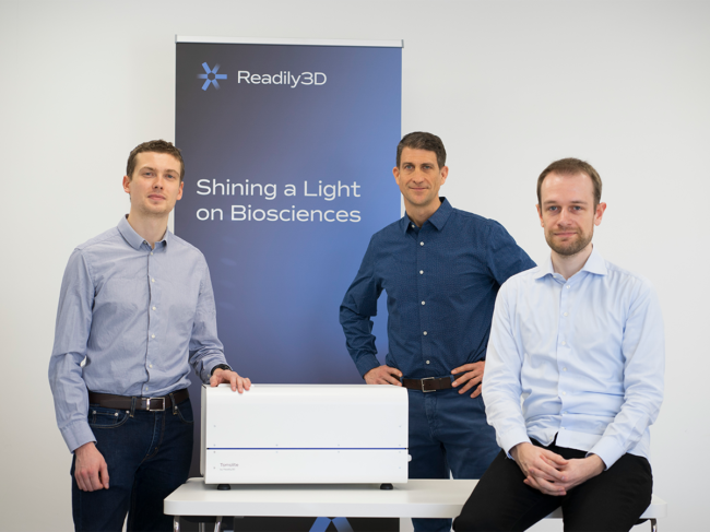The three co-founders of Readily3d standing with the Tomolite printer