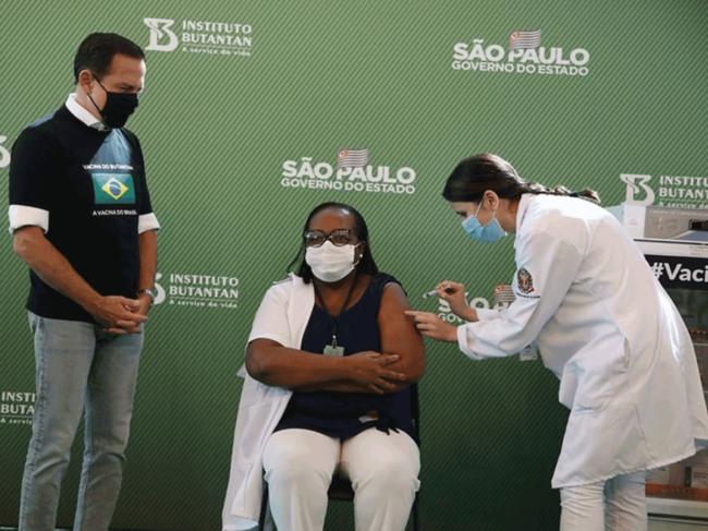 Woman gets COVID-19 vaccine in Brazil