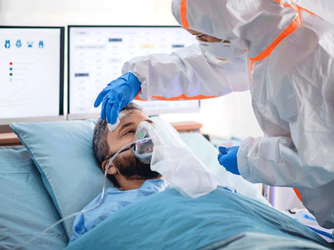 Ventilated patient in quarantine receiving care