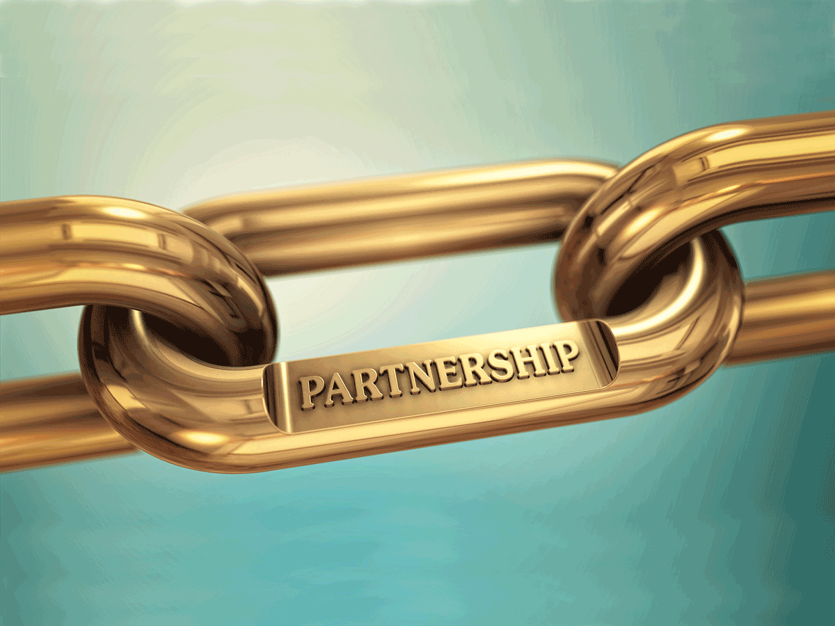 "Gold chain link engraved with ""partnership"""