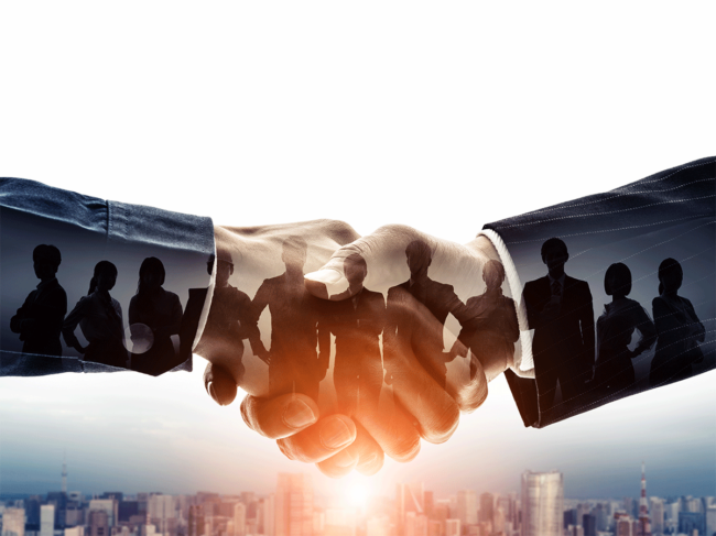 Handshake with cityscape and businesspeople