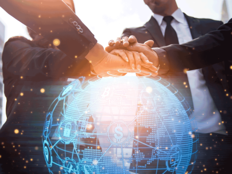Business people with hands atop a digital globe
