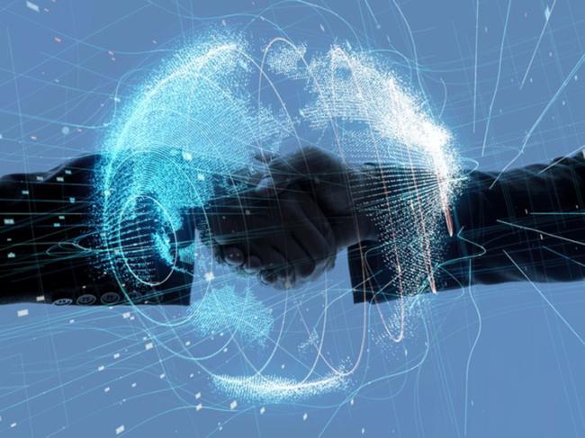 Handshake behind digital globe