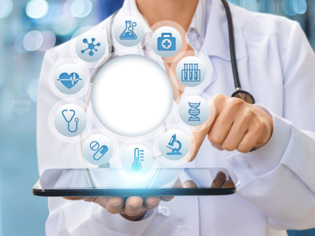 Health professional holding tablet, medical icons