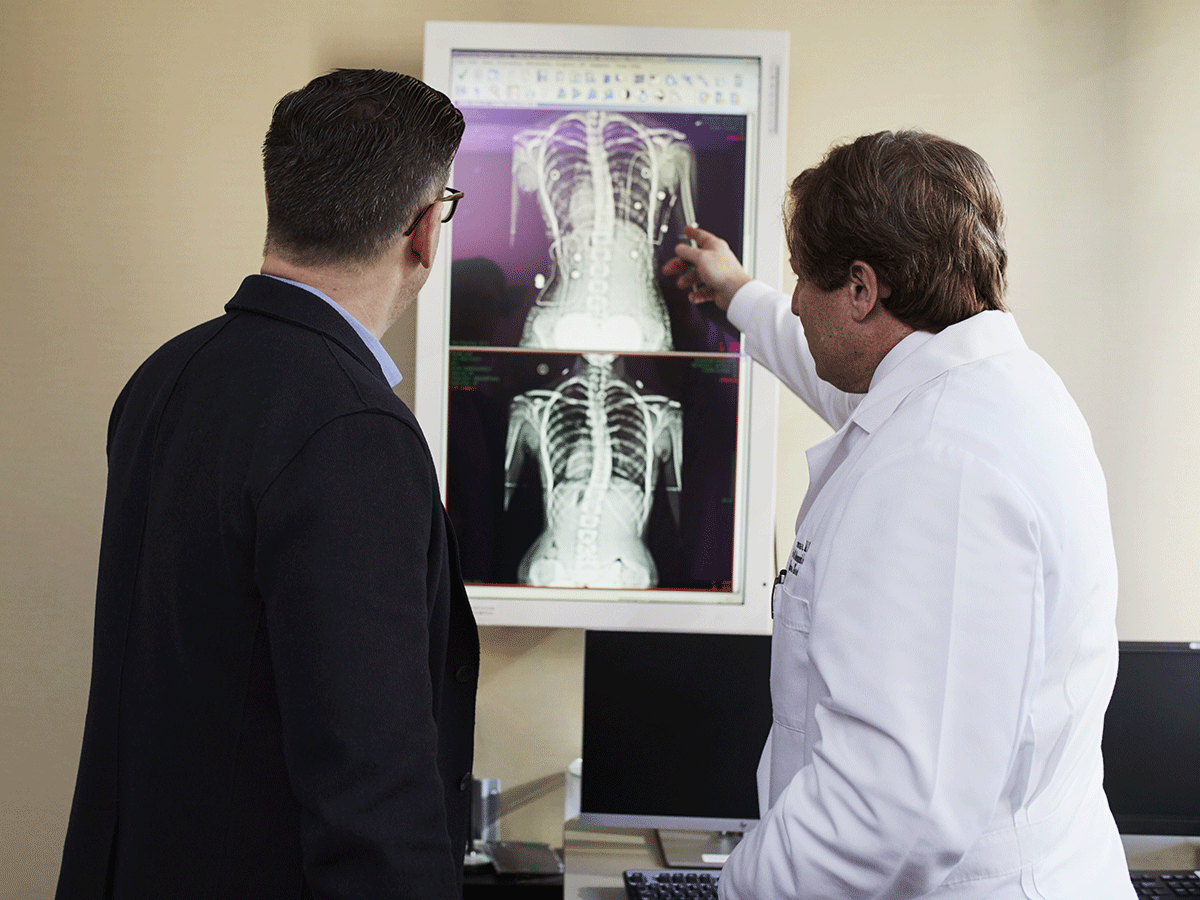 Men reviewing chest X-rays