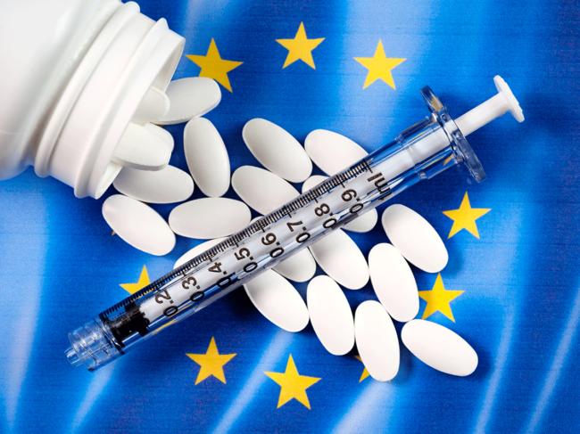 EU flag, pills, syringe