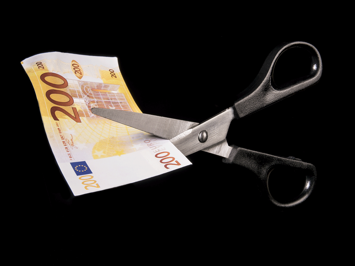Scissors cutting Euro
