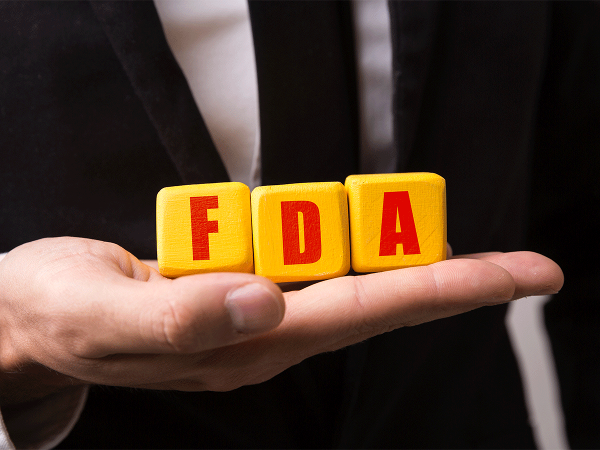 Hand holding FDA blocks