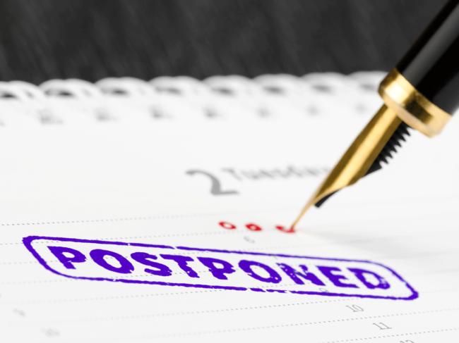 Postponed stamp on calendar