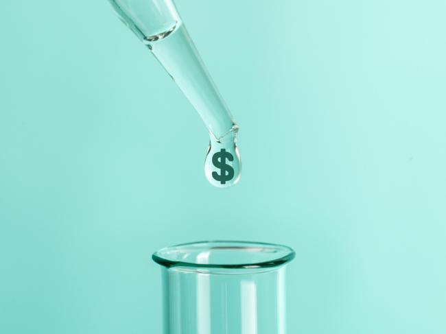 Dollar sign droplet above test tube