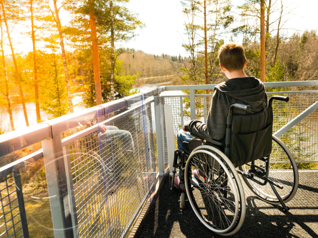 Boy in wheelchair, scenic overlook
