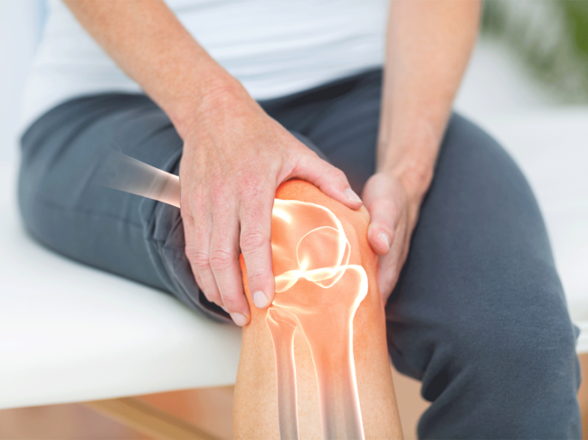 Person holding knee, joint pain
