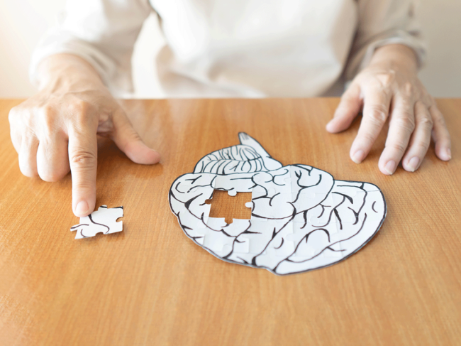 Elderly woman and jigsaw puzzle