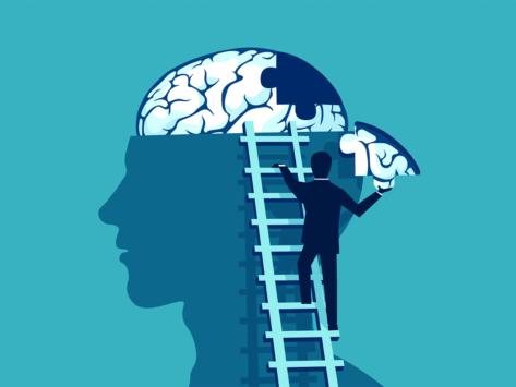 Man-adding-piece-to-brain