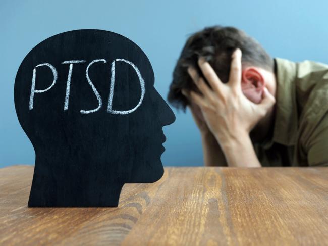 PTSD chalk silhouette, man holding head