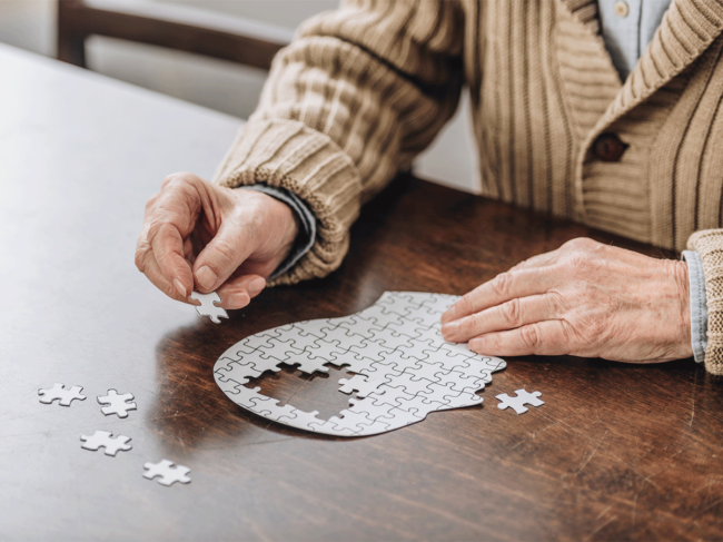 Man piecing together a puzzle