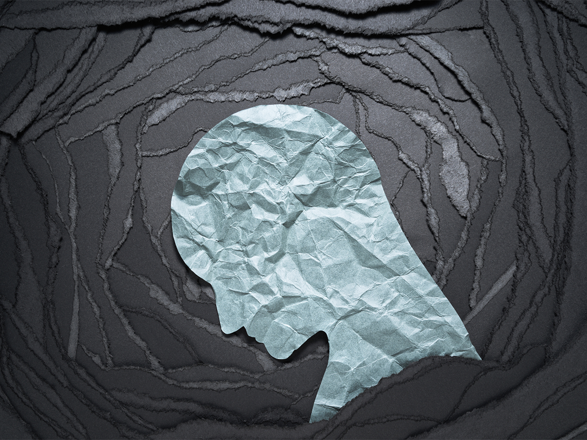 Silhouette made of crumpled paper illustrating depression