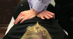 A patient receives a chiropractic thoracic adjustment
